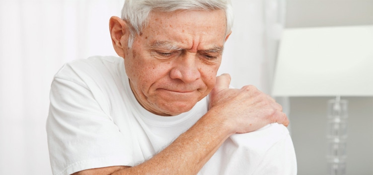Old Man Suffering from Shoulder Pain